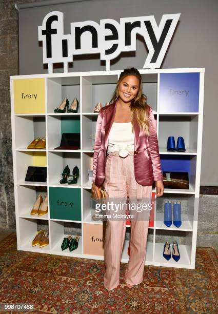 Chrissy Teigen attends the Finery App launch party hosted by Brooklyn Decker at Microsoft Lounge on July 11 2018 in Culver City California
