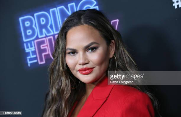 Chrissy Teigen attends the premiere of NBC's Bring The Funny at Rockwell Table Stage on June 26 2019 in Los Angeles California