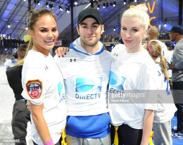 Chrissy Teigen Chace Crawford and Ireland Baldwin participate in the DirecTV Beach Bowl at Pier 40 on February 1 2014 in New York City