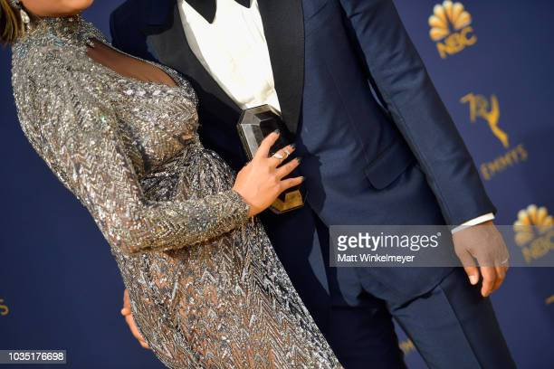 Chrissy Teigen fashion detail and John Legend attend the 70th Emmy Awards at Microsoft Theater on September 17 2018 in Los Angeles California