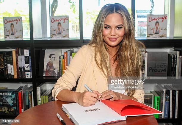 Chrissy Teigen greets fans and signs copies of her book 'Cravings' at Books and Books At Adrienne Arsht Center on February 26 2016 in Miami Florida