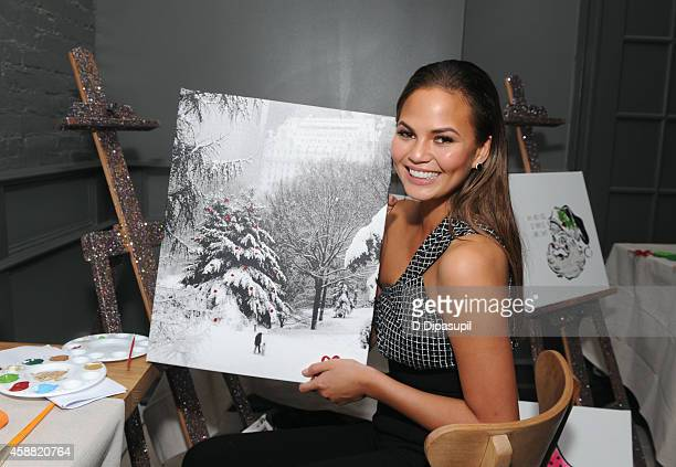Chrissy Teigen hosts Shutterfly's Wine, Dine and D.I.Y. Design Holiday Event at Sopra on November 11, 2014 in New York City.