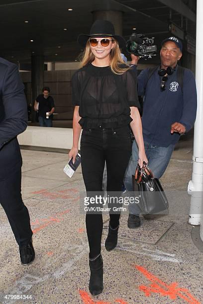Chrissy Teigen is seen at LAX on July 08 2015 in Los Angeles California