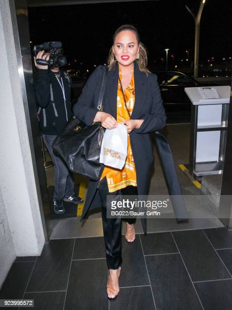 Chrissy Teigen is seen at Los Angeles International Airport on February 24 2018 in Los Angeles California