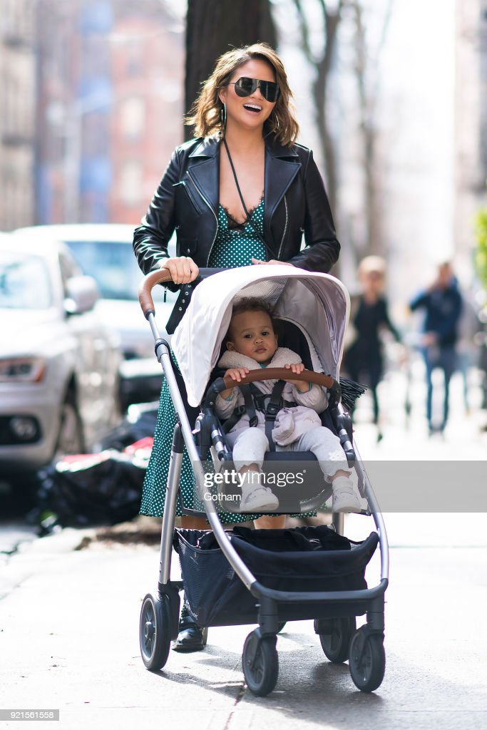 Chrissy Teigen is seen walking her daughter Luna in SoHo on February 20, 2018 in New York City.