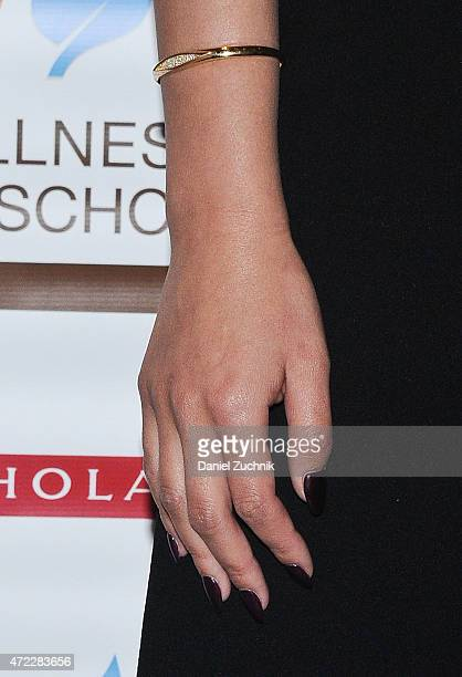 Chrissy Teigen jewelry details attends the Wellness In The Schools 10th Anniversary Gala at Riverpark on May 5 2015 in New York City
