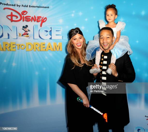 Chrissy Teigen John Legend and daughter Luna attend Disney On Ice Presents Dare to Dream Celebrity Skating Party at Staples Center on December 14...