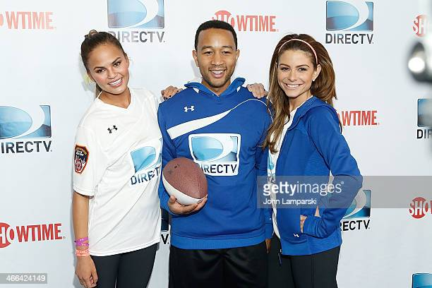 Chrissy Teigen John Legend and Maria Menounos attend DIRECTV's 8th Annual Celebrity Beach Bowl on February 1 2014 in New York City