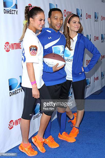 Chrissy Teigen John Legend and Maria Menounos attend the DirecTV Beach Bowl at Pier 40 on February 1 2014 in New York City