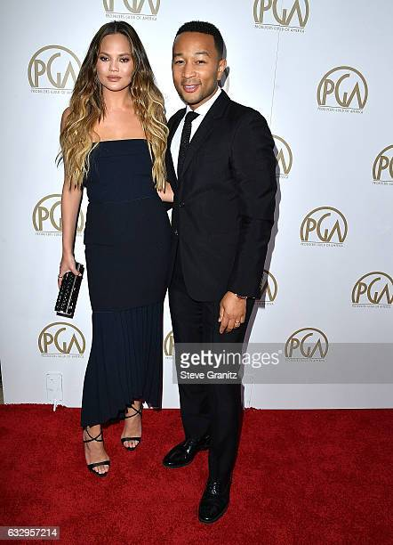 Chrissy Teigen John Legend arrives at the 28th Annual Producers Guild Awards at The Beverly Hilton Hotel on January 28 2017 in Beverly Hills...