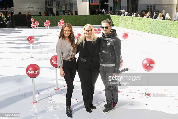 Chrissy Teigen Karin Timpone and Casey Neistat attend as Marriott International celebrates Global Travel Day at Rockefeller Center in NYC on October...