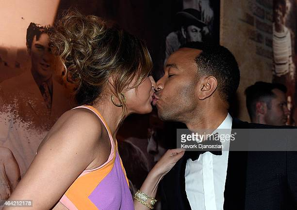 Chrissy Teigen kissed John Legend during the 87th Annual Academy Awards Governors Ball at Hollywood Highland Center on February 22 2015 in Hollywood...