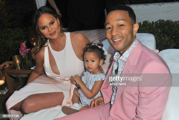 Chrissy Teigen Luna Simone Stephens and John Legend attend John Legend's launch of his new rose wine brand LVE during an intimate Airbnb Concert on...