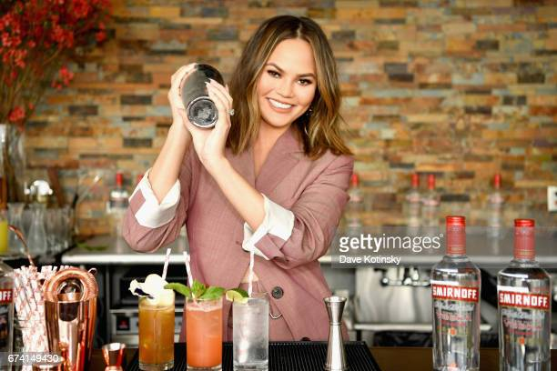 Chrissy Teigen mixes up a ''Pepper Thai Cocktail' with Smirnoff No 21 at Canoe Studios on April 27 2017 in New York City