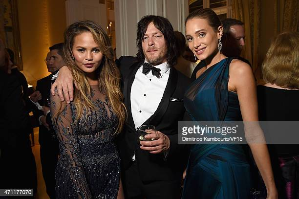 Chrissy Teigen Norman Reedus and Hannah Davis attend the Bloomberg Vanity Fair cocktail reception following the 2015 WHCA Dinner at the residence of...
