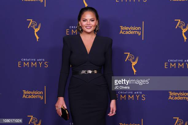 Chrissy Teigen poses in the press room during the 2018 Creative Arts Emmy Awards at Microsoft Theater on September 9 2018 in Los Angeles California