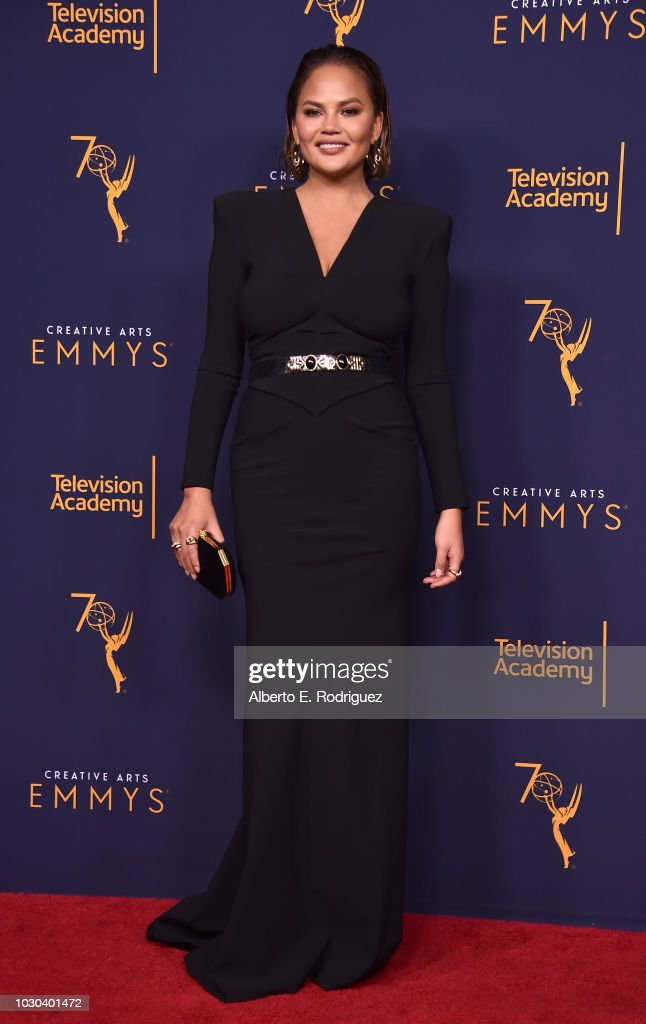 Chrissy Teigen poses in the press room during the 2018 Creative Arts Emmys at Microsoft Theater on September 9, 2018 in Los Angeles, California.