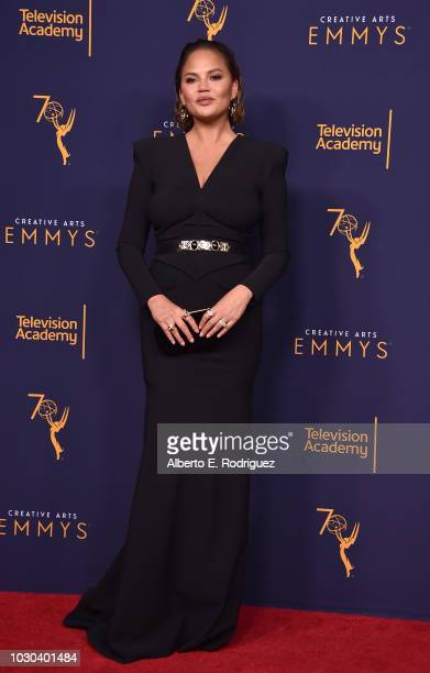 Chrissy Teigen poses in the press room during the 2018 Creative Arts Emmys at Microsoft Theater on September 9 2018 in Los Angeles California