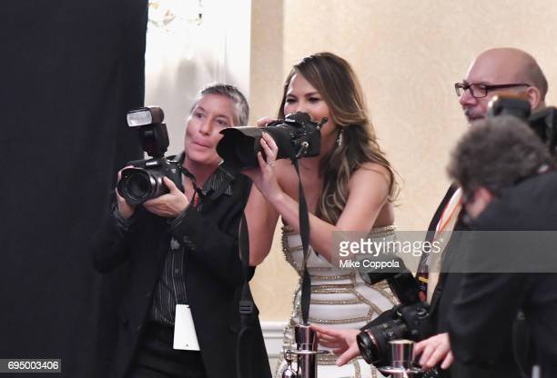 Chrissy Teigen shoots photos in the press room during the 2017 Tony Awards at 3 West Club on June 11, 2017 in New York City.