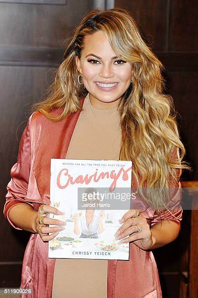 Chrissy Teigen signs copies of her new book 'Cravings Recipes For All The Food You Want To Eat' at Barnes Noble at The Grove on February 23 2016 in...
