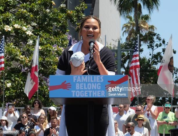 Chrissy Teigen speaks at the Families Belong Together Freedom For Immigrants March at Los Angeles City Hall on June 30 2018 in Los Angeles California