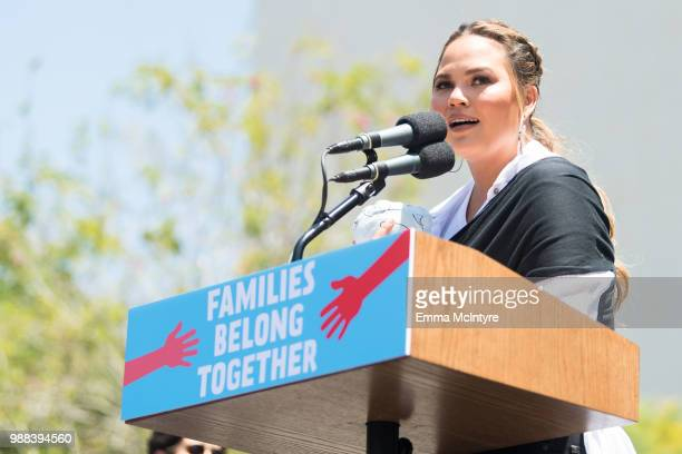 Chrissy Teigen speaks onstage at 'Families Belong Together Freedom for Immigrants March Los Angeles' at Los Angeles City Hall on June 30 2018 in Los...