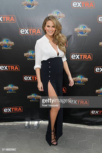 Chrissy Teigen visits 'Extra' at Universal Studios Hollywood on March 11 2016 in Universal City California