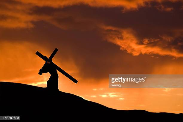 Christ Carrying the Cross With an Orange Sunset
