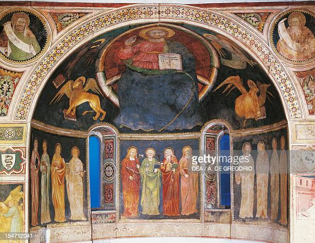 Christ in Majesty between symbols of the evangelists and the twelve Apostles frescoes in the niche of the apse Visconti Oratory Albizzate Italy 14th...