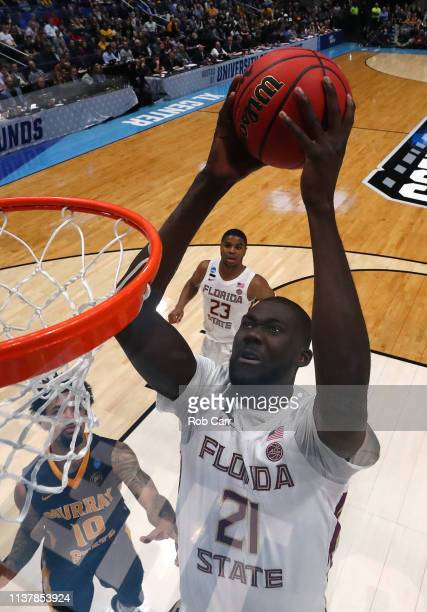 Christ Koumadje of the Florida State Seminoles attempts a shot against the Murray State Racers in the second half during the second round of the 2019...