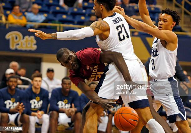 Christ Koumadje of the Florida State Seminoles makes a pass against Terrell Brown of the Pittsburgh Panthers at Petersen Events Center on January 14...