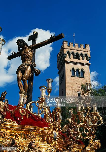 Christ on the Cross Paso carried in procession during Holy Week Seville Andalusia Spain
