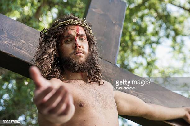 Christ on the Cross Reaches Out to Viewer