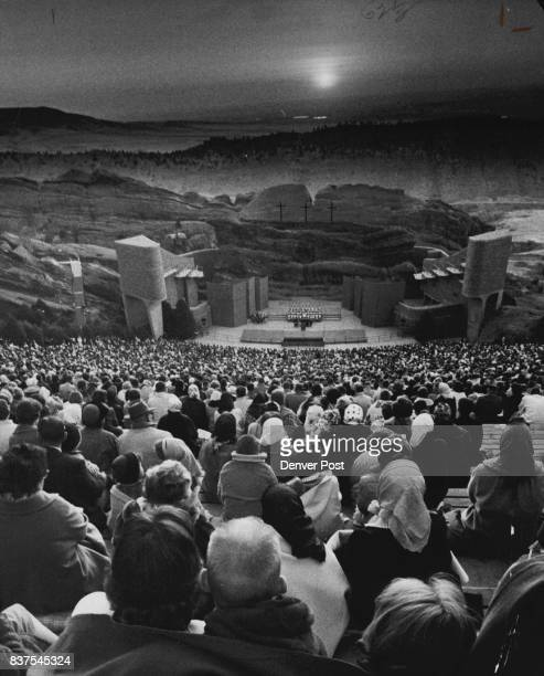 Christ the Lord is Risen Today Alleluia Easter down breaks over the crowd of more than 10000 worshipers in Red Rocks Amphitheater for the traditional...