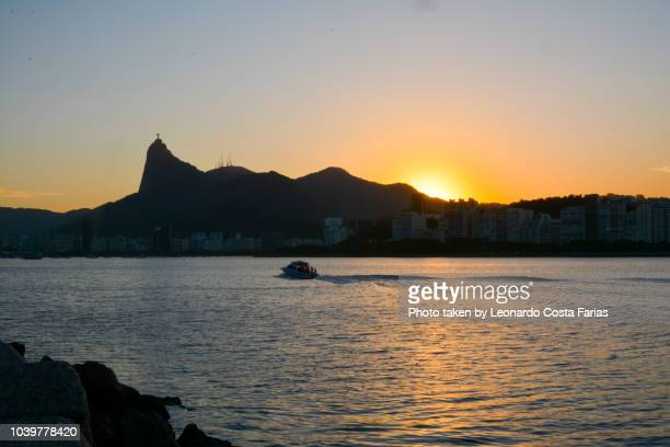 christ the redeemer at sunset - leonardo costa farias stock photos and pictures