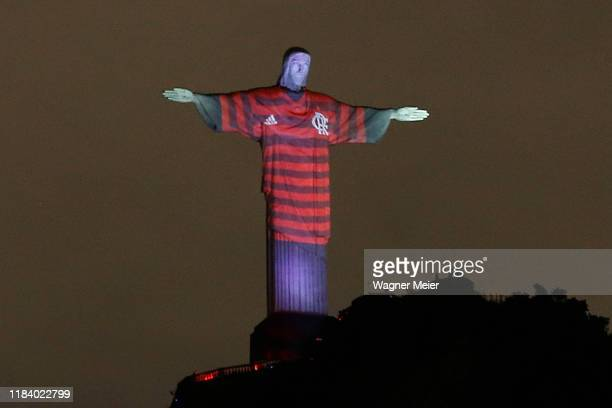 Christ the Redeemer is Lit Up with Flamengo Colors Ahead of the Copa CONMEBOL Libertadores 2019 Final Against River Plate on November 22 2019 in Rio...