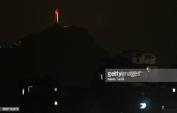 Christ the Redeemer statue is lit in the colors of the Paralympic torch the night before the start of the Rio 2016 Paralympic Games with the...