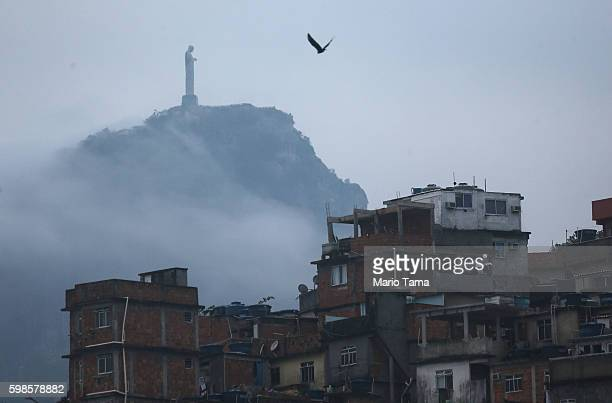 Christ the Redeemer statue stands above the Cantagalo 'favela' community on September 1 2016 in Rio de Janeiro Brazil The city is set to host the Rio...