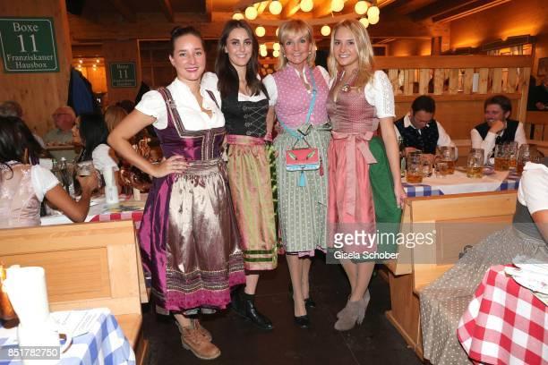 Christa Kinshofer with her daughter Stephanie step daughter Laura Rembeck and daughter Alexandra Kinshofer during the Oktoberfest at Schuetzen...
