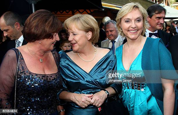 Christa Stewens Angela Merkel and Barbara Merk arrive for the 'Parsifal' premiere of the Richard Wagner festival on July 25 2008 in Bayreuth Germany
