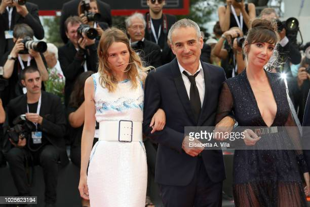Christa Theret Olivier Assayas and Nora Hamzawi walk the red carpet ahead of the 'Doubles Vies ' screening during the 75th Venice Film Festival at...