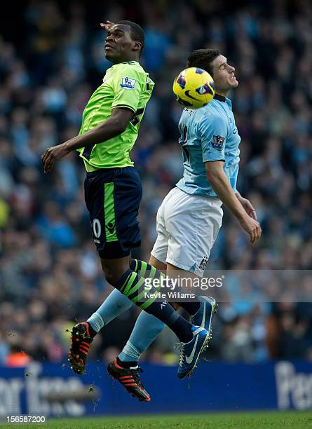 Christain Banteke of Aston Villa is challenged by Gareth Barry of Manchester City during the Barclays Premier League match between Manchester City...
