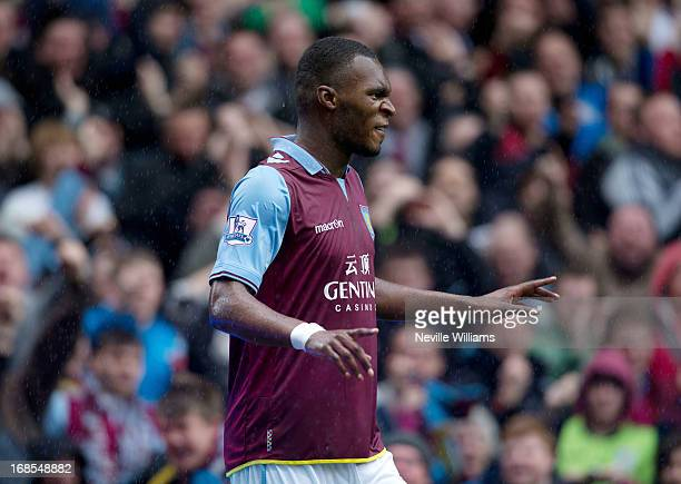 Christain Benteke of Aston Villa celebrates after scoring during the Barclays Premier League match between Aston Villa and Chelsea at Villa Park on...