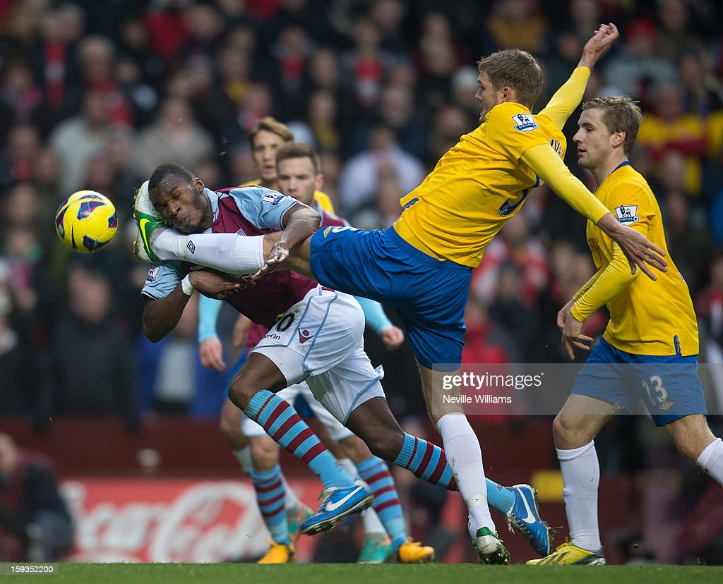 Christain Benteke of Aston Villa is challenged by Jos Hooiveld of Southampton during the Barclays Premier League match between Aston Villa and Southampton at Villa Park on January 12, 2013 in Birmingham, England.