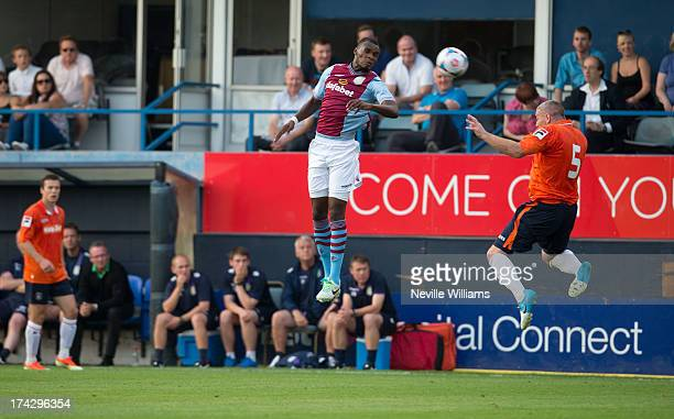 Christain Benteke of Aston Villa is challenged by Steve McNulty of Luton Town during the Pre Season Friendly match between Luton Town and Aston Villa...