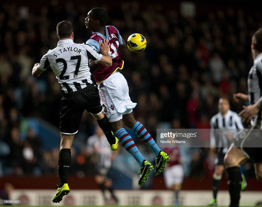 Christain Benteke of Aston Villa is challenged by Steven Taylor of Newcastle United during the Barclays Premier League match between Aston Villa and Newcastle United at Villa Park on January 29, 2013 in Birmingham, England.