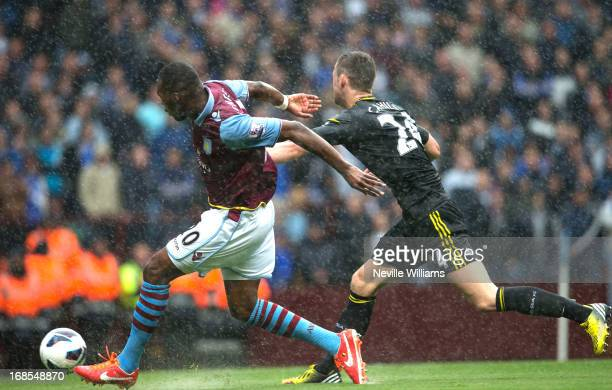 Christain Benteke of Aston Villa scores during the Barclays Premier League match between Aston Villa and Chelsea at Villa Park on May 11 2013 in...