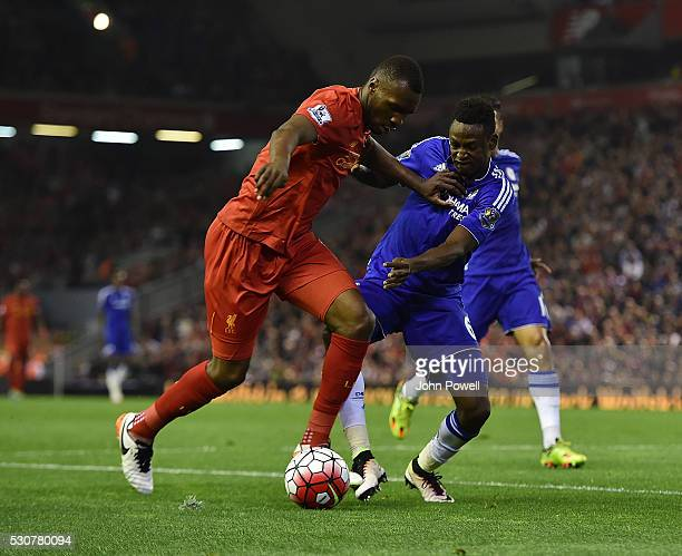 Christain Benteke of Liverpool competes with Baba Rahman of Chelsea during the Barclays Premier League match between Liverpool and Chelsea at Anfield...