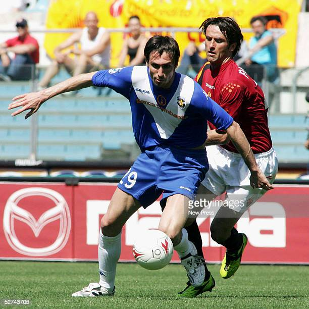 Christain Panucci of Roma and of Andrea Caracciolo Brescia in action during the Serie A match between AS Roma and Brescia at the Stadio Olimpico on...