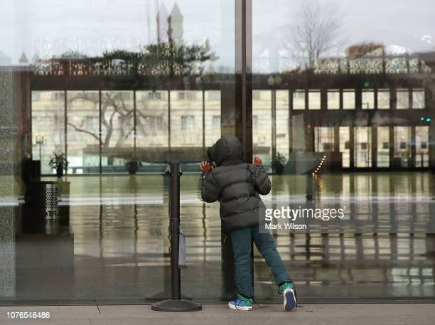 Christain SaintSurin 7 yearsold of Miami Florida looks inside the National Museum of African American History that is closed due to the partial...